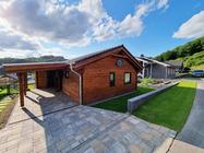 Haus am See - 90 qm Wohnfläche mit Fußbodenheizung - Fass-Sauna im Feriendorf Rieden Eifel.
